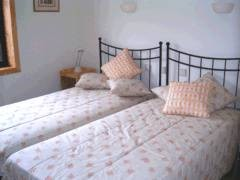 Bedroom at Casa Santa Rita Cottages - Self catering accommodation overlooking the ocean